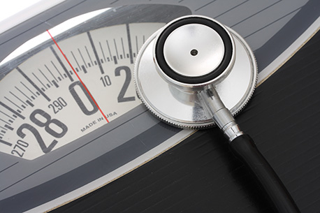 Photo of stethoscope on scale