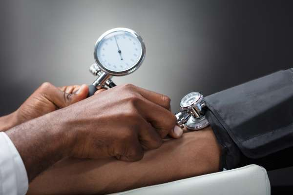 Photo of patient getting blood pressure checked