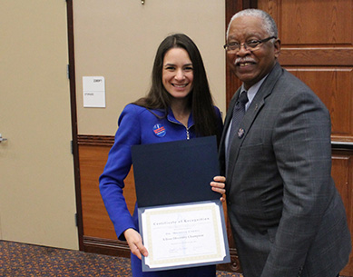 Henry T. Frierson, Ph.D., associate vice president and dean of the Graduate School at UF, presents a Champion of Diversity Award of Recognition to Michelle Cardel, Ph.D., M.S., R.D., at UF's 2019 Graduate Research Day on April 2.