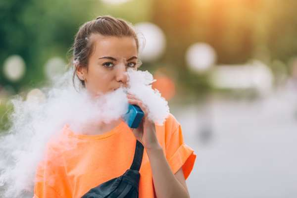 Teenage girl vaping